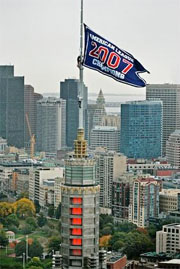 weather beacon fitted with a red sox championship banner sits atop the John Hancock building in Boston's Copley Square