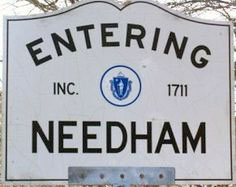 sign for the town of Needham MA