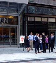 AOL employees wait to go into the Burnham building in downtown crossing