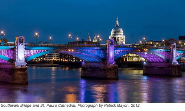 Southwark bridge lit at night